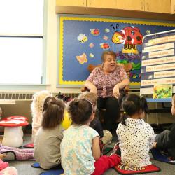 Whitehaven Jayne reading to the children